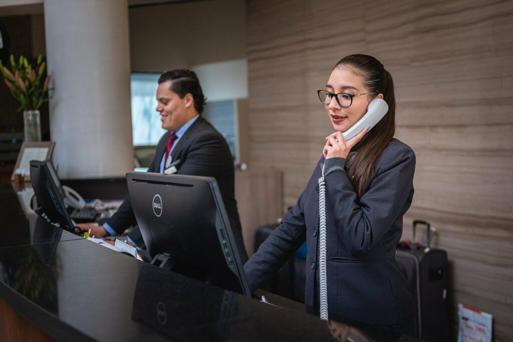 A hotel receptionist on the phone