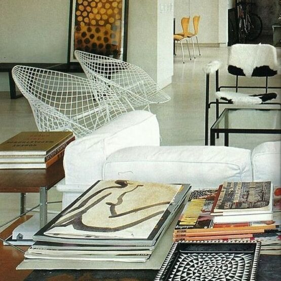 Room with coffee table with coffee table books: creative agency page